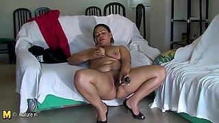 Big chunky Latin mama riding a rubber dildo