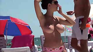 South European girl with big boobs on the beach