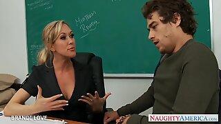 Blonde teacher Brandi Love riding cock in classroom