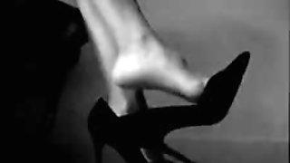 Sister dangling high heels in pantyhose.