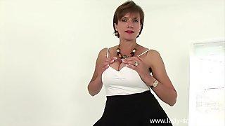 Dirty talking British milf teases her big tits