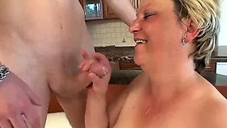 Old vagina fucked by the young guy and her titties take his load