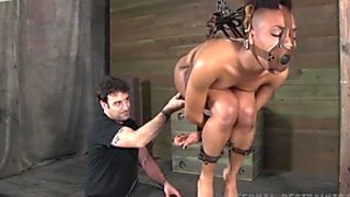 Caramel hottie Nikki Darling gets her soaking pussy fucked BDSM way