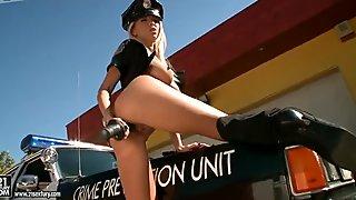 Seductive cop Clara G enjoys baton on the car hood