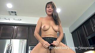 Elexis Monroe has fun masturbating in her kitchen